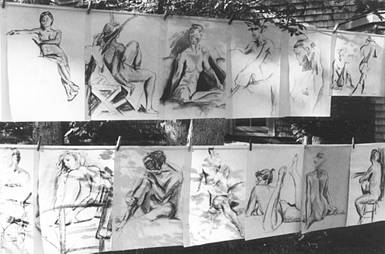 "18""x24"" figure drawings hanging from clotheslines outside"